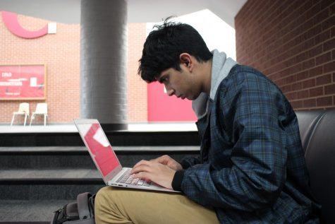Coppell junior Quiz Bowl co-captain Vishal Sivamani studies for a tournament. The Quiz Bowl team qualified for the Pace National Scholastic Championship this year which will take place in Virginia and the HSNCT National Championship which will be located in Atlanta this year.