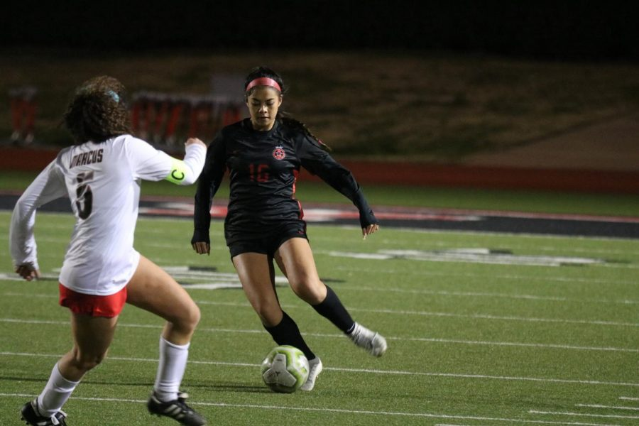 Coppell junior defender Chloe Pham passes during the match on Tuesday against Marcus at Buddy Echols Field. The Cowgirls face District 6-6A leader Flower Mound tomorrow at 7:30 p.m. at Buddy Echols Field.