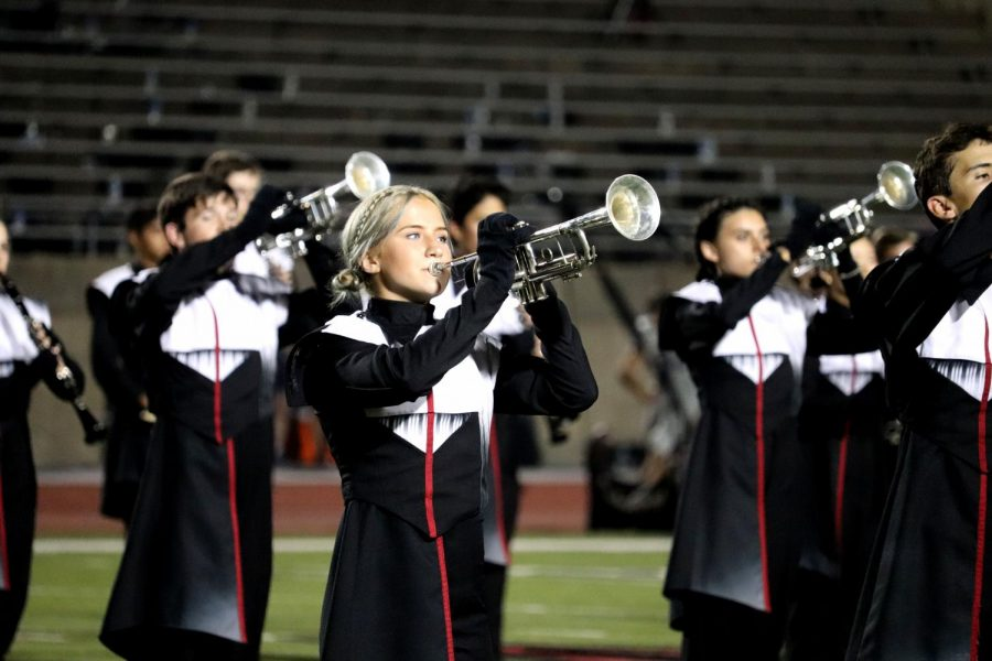 Coppell High School Band members perform at the first home football game of the season against L.D. Bell on Sept. 6. CHS9 student Iniya Nathan thinks marching band should be considered a sport.
