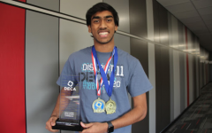 Coppell High School senior Rushil Nakkana displays winnings from this weekend's DECA State Career Development Conference at the Fort Worth Convention center. In these competitions, members receive business scenarios and work in groups of two to find a solution in hopes of advancing to internationals.