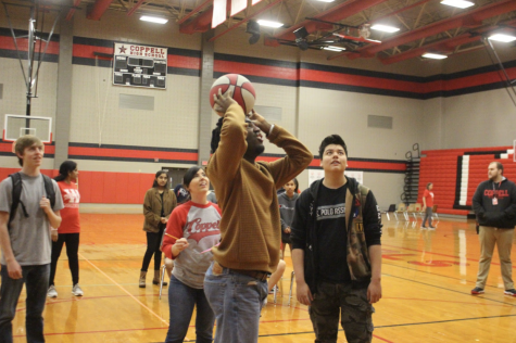 Coppell High School senior Miles Williams takes the shot at the first Special Olympics Skills Competition and Unified Games in the CHS large gym today. Williams and other special education students participate in order to test their physical activities skills.
