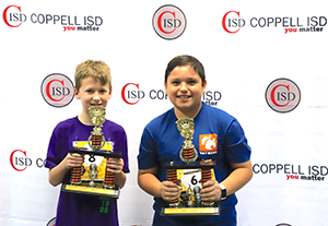 Denton Creek Elementary fifth graders Bruno Castillo and Eric Hall hold their trophies from the Coppell ISD Spanish Spelling Bee. Castillo won first place and is advancing to the regional competition; Hall was runner up. Photo courtesy Coppell ISD.