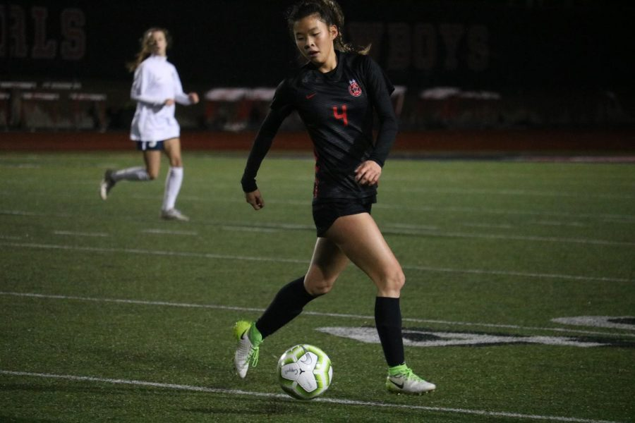 Coppell+sophomore+forward+Michelle+Pak+dribbles+against+Flower+Mound+at+Buddy+Echols+Field+on+Feb.+11.+The+Cowgirls+play+Hebron+tomorrow+at+7%3A30+p.m.+at+Buddy+Echols+Field.+