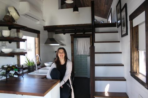 Coppell High school astronomy and earth space and space science teacher Angela Barnes in her tiny home's kitchen, on Feb 2. Barnes has been living in her new home for about nine months to be more energy-efficient and reduce her carbon footprint.