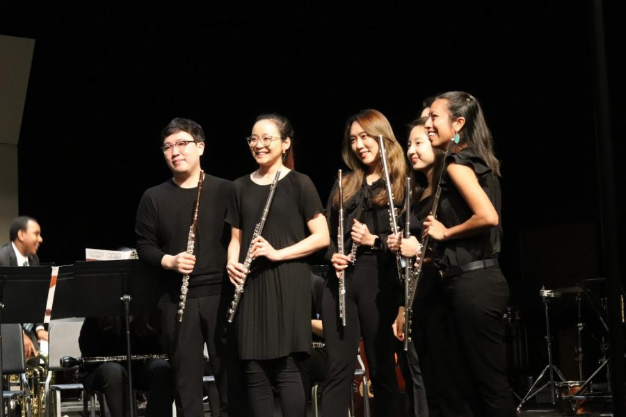 """Flutists from the Dallas Asian Wind Ensemble pose after its """"Movie In Concert"""" in the CHS Auditorium on Sunday night. The concert featured scores from movies such as Harry Potter, Star Wars and Mulan."""