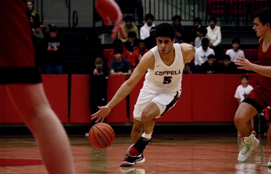 Coppell senior guard Adam Moussa makes a break for the basket against Marcus on Jan. 31 in the CHS Arena. The Cowboys led throughout and won, 65-61.