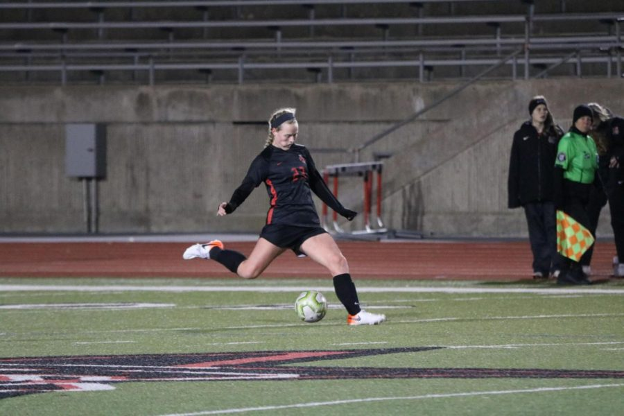Coppell sophomore midfielder Bailey Peek passes during the match against Marcus yesterday at Buddy Echols Field. Despite an offensive surge in the second half, the Cowgirls fell to the Marauders, 3-2.