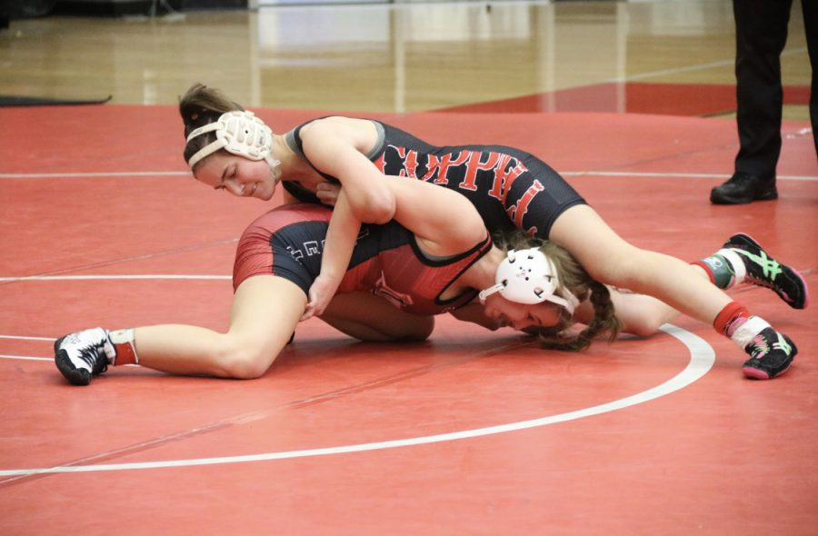 Coppell freshman wrestler Scout Carrell runs a snake on Lovejoy freshman Brindley Eaton during the Knockout Sportswear Cowgirl Classic on Dec. 6 in the CHS Arena. Carrell advanced to the 2020 UIL Girls State Championship in the 110 pound weight class, which was Feb. 21-22 at the Berry Center in Houston.