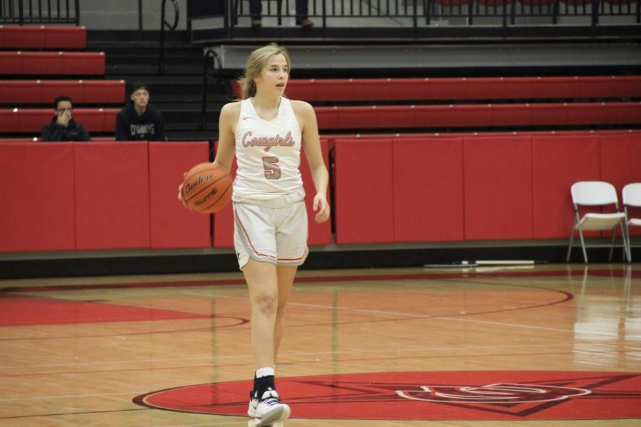 Coppell freshman guard Jules LaMendola brings the ball upcourt  in the CHS Arena on Friday against Marcus. LaMendola is on the varsity team and is back on the court after suffering an injury in November. Photo by Neveah Jones.