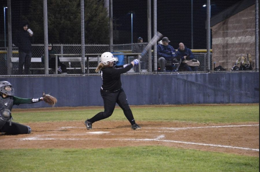 Coppell junior pitcher Michaella Baker hits the ball across the field during Friday night's scrimmage against Prosper at the CISD Baseball/Softball Complex. The Cowgirls lost against the Eagles, 4-5.