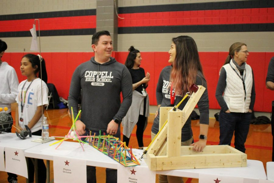 Coppell High School teachers Jonathan Denton and Cynthia Lee present projects constructed by current on-level and honors physics students in the CHS main gym on Feb. 11. Teachers were stationed throughout the gym, cafeteria and commons for the Spring Showcase, which gave students and parents the opportunity to inquire about courses for the 2020-21 school year.