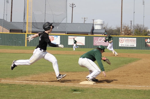 Coppell junior second baseman Tony Vernars is thrown out at first against Birdville on Saturday. Coppell played its first home scrimmage at the Coppell ISD Baseball Complex.