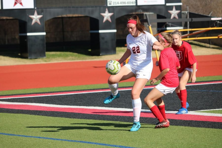 Coppell senior midfielder Maya Ozymy protects from Belton defenders during the scrimmage on Dec. 14, 2019 at Buddy Echols Field. Ozymy made a verbal commitment to Trinity University on Aug. 8. Sidekick file photo.