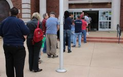 Voters stand in line at the Coppell City Hall to vote on Super Tuesday. Democratic Presidential Candidate Joe Biden won the Democratic Primary in Texas while President Donald Trump won the Republican Primary in Texas.