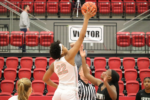 Coppell sophomore forward India Howard wins possession for the Cowgirls at tipoff against Irving in the CHS Arena on Jan. 11. Howard made the All-District 6-6A second team.