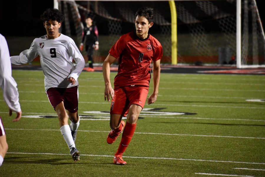 Coppell senior defender Nathan Hernandez delivers a pass against Lewisville on Jan 31 at Buddy Echols Field. Hernandez has been working out this week by practicing soccer with one or two friends due to the UIL suspending all school practices outside of school hours, including the use of school facilities