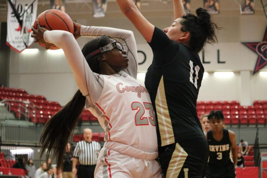 Coppell senior guard Nicole Obialo passes around Irving junior guard Bessy Alvarado on Jan. 11 at the CHS Arena. Obialo made the All-District 6-6A second team.