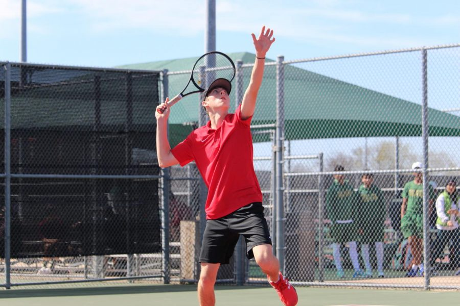 Coppell senior Clark Parlier serves during his doubles match against Frisco Centennial at the CHS Tennis Center yesterday. The Coppell tennis team hosted the Coppell Breakout and placed second overall, with Parlier and his doubles partner, Coppell sophomore Vinay Patel, placing first in boys A doubles.