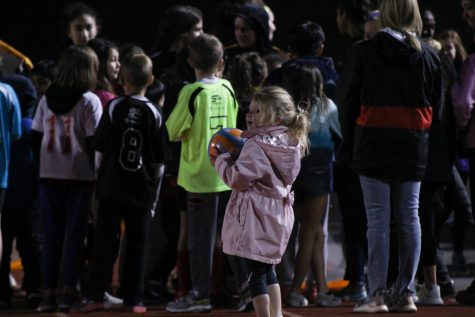 Three-year-old Addison Keogh joins other Coppell elementary school children on Buddy Echols Field for halftime activities on Friday. The Coppell girls soccer team hosted Youth Night for children to meet the Cowgirls and partake in halftime activities.