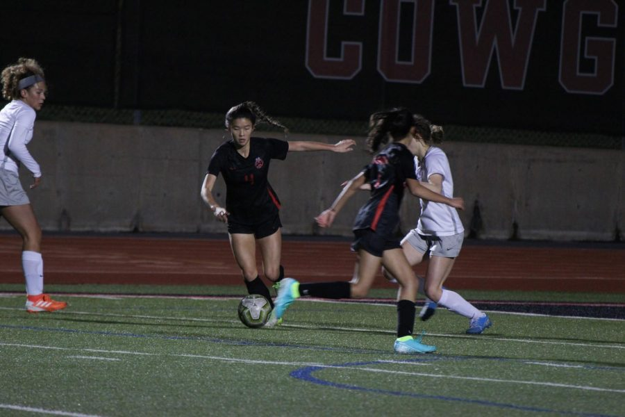 Coppell sophomore forward Michelle Pak scores against Lewisville on Friday night at Buddy Echols Field. The Cowgirls defeated Lewisville, 5-1.