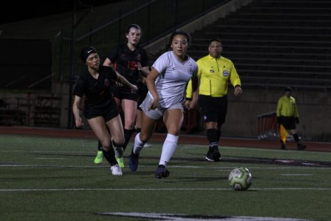 Lewisville junior midfielder Adamaris Manjarrez (right) escapes from Coppell senior forward Maggie Roberts (left) and sophomore midfielder Claire Yaney (19) on Friday at Buddy Echols Field. The Cowgirls defeated Lewisville, 5-1.