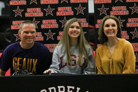Coppell senior Shelby Spoor signs to Louisiana State University for track and cross country beside her parents, Coppell boys golf and assistant cross country coach Jason Spoor and Leia Spoor, in the CHS Arena on Feb. 5. Spoor signed to LSU after considering various offers from universities throughout Texas.