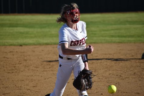 Coppell sophomore pitcher Katherine Miller pitches against Cedar Hill on March 7 at the Coppell ISD Softball Complex. The Cowgirls defeated Cedar Hill, 7-5, in their last game of the Coppell & Marcus Tournament.