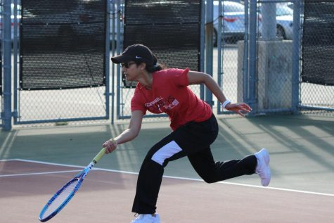 Coppell junior Rishita Uppuluri chases a volley during her doubles match at the CHS Tennis Center on Feb. 7 during the Coppell Super Bowl. The Coppell tennis team hosts the Coppell Breakout Tournament today beginning at 8 a.m.