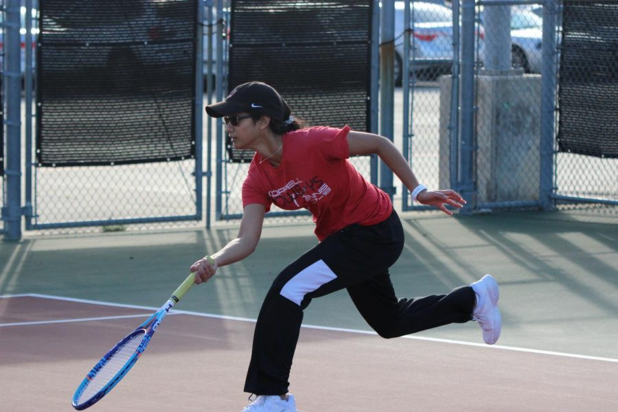 Coppell+junior+Rishita+Uppuluri+chases+a+volley+during+her+doubles+match+at+the+CHS+Tennis+Center+on+Feb.+7+during+the+Coppell+Super+Bowl.+The+Coppell+tennis+team+hosts+the+Coppell+Breakout+Tournament+today+beginning+at+8+a.m.