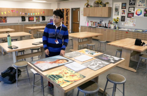 CHS9 student Jeffrey Wang displays his art in CHS9 art instructor Elsa Reynolds's class on Feb. 24. Wang qualified for the Visual Arts Scholastic Event (VASE) competition and volunteers to paint sunflowers at The Gatehouse. Photo by Anthony Onalaja
