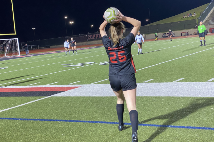 Coppell senior Caroline Dunn throws in against Irving at Buddy Echols Field last night. The Cowgirls defeated the Tigers, 10-0.