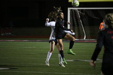 Coppell junior forward Jojo Alonzo wins a header against Flower Mound on Feb. 11 at Buddy Echols Field. The Cowgirls face Irving tomorrow at 7:30 p.m. at Buddy Echols Field.