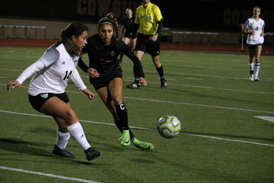 Hebron senior defender Maria Sosa takes a touch against Coppell junior forward Jocelyn Alonzo at Buddy Echols Field on Feb. 25. The Cowgirls defeated the Hawks, 4-3.