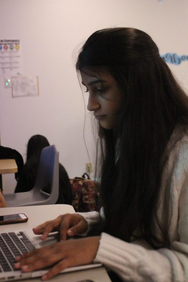 Coppell High School sophomore Isha Kulkarni works on her page design during Sallyanne Harris's second period Round-Up yearbook class. Kulkarni is a first-year staff member on Round-Up.