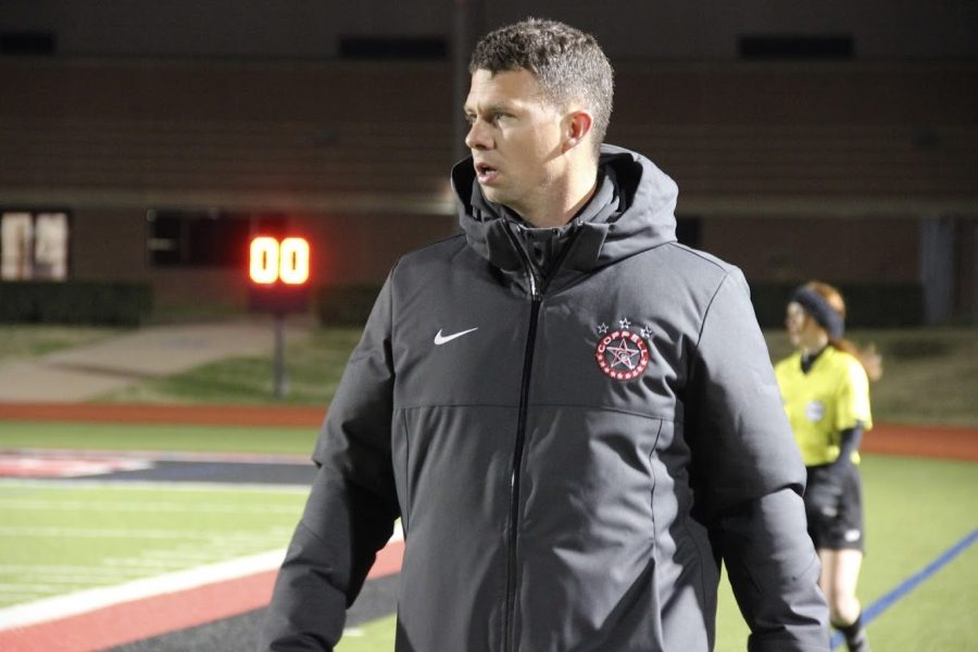 Coppell coach James Balcom watches the action at Buddy Echols Field on Feb. 23 against MacArthur. Balcom has been coaching the Coppell boys soccer team for nine years and teaches world geography at CHS9.
