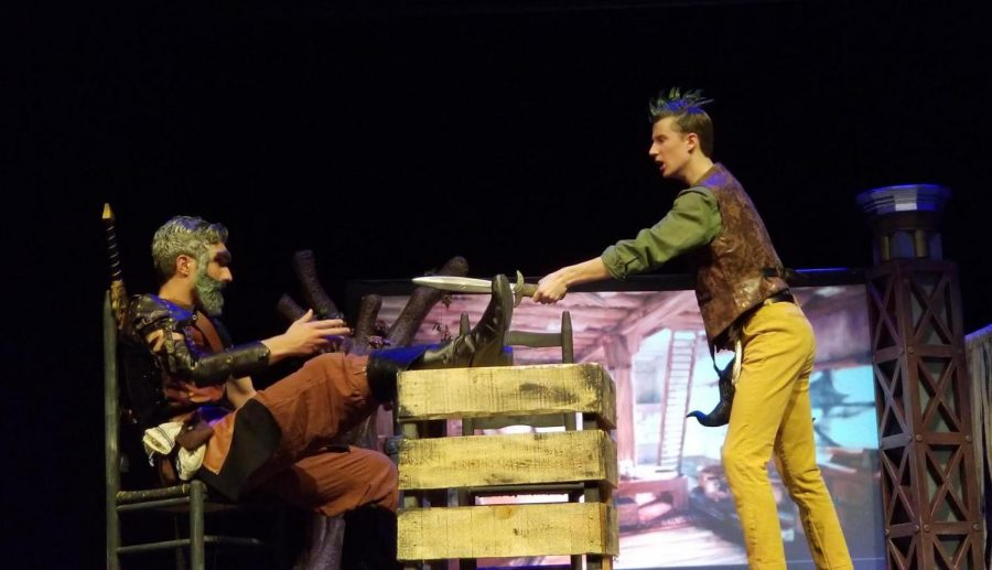 "Coppell High School senior Drew Scrivner who plays Lief in CHS Theatre's One Act Play ""Bandersnatch"" holds a sword to CHS junior Matthew O'Quinn, who plays Lief's grandfather Grehner. ""Bandersnatch"" is based off Lewis Carroll's ""The Jabberwocky"" and was performed. yesterday night in the CHS Auditorium."