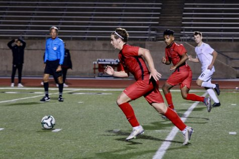 Coppell senior midfielder Sebastian Blaas dribbles against Marcus on Tuesday at Buddy Echols Field. The Cowboys upset the state's No. 1 ranked team, 2-1, on a goal by senior striker Tom Vazhekatt with 10 minutes to play in the match.
