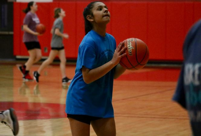 Coppell sophomore JV guard Tia Pandey prepares to shoot during practice on Feb. 21 in the CHS small gym. Pandey has been playing basketball since she was in fifth grade and hopes to make varsity next year.