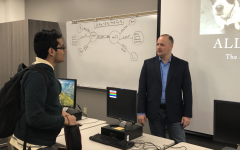 Coppell High School band director Brandon Slovak answers a question from senior Mohsin Ali in his All About Bills class. Seniors are participating in #Adulting Day classes to learn more about real-world skills.