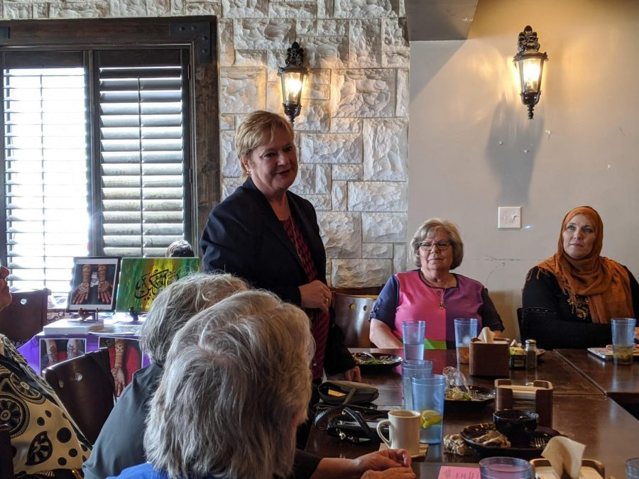 Dallas County Commissioner Theresa Daniel addresses attendees of a Women's Day event at Andalous Mediterranean Buffet in Richardson on March 8. The event commemorated International Women's Day and Women's History Month.