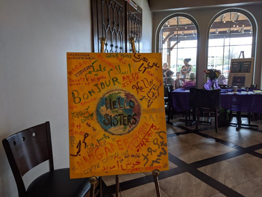 A painted sign that says 'hello' in many languages is displayed at a Women's Day event at Andalous Mediterranean Buffet in Richardson on March 8. The event commemorated International Women's Day and Women's History Month.