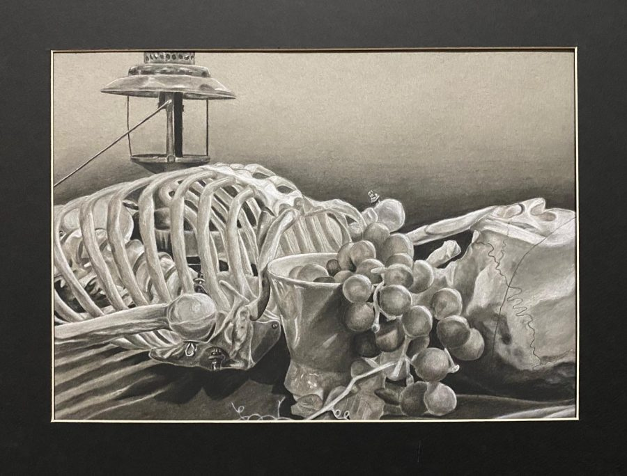 """Fruit of the Dead"" is a charcoal still-life of a skeleton, bowl of fruit and dimmed lantern. This piece is currently displayed at the Young American Art exhibition at El Centro College in Downtown Dallas."