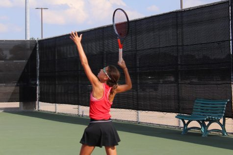 Coppell freshman Lindsay Patton serves during eighth period tennis  practice at the CHS Tennis Center. Patton has risen to the top ranks of the girls tennis team in a matter of a year, where she competes against players bigger and older than her.