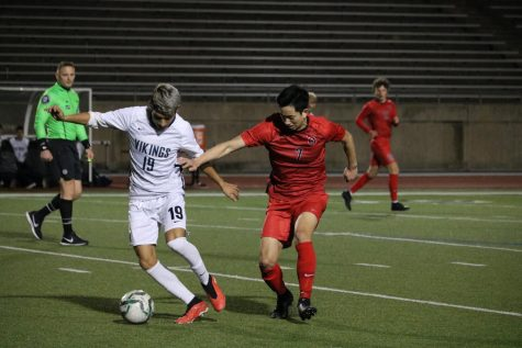 Irving Nimitz's Jonathan Morales dribbles away from Coppell senior midfielder Ben Wang on Feb. 18 at Buddy Echols Field. Wang plays for the Coppell boys soccer team, which placed second in District 6-6A last year, and is ranked 13th in his class.
