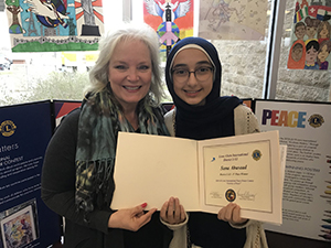 Coppell Middle School West eighth grader Sana Abusaad won first place at the multi-district level of the  International Peace Poster Contest with Coppell Middle School West Art teacher Gail Cary. Abusaad's poster will move on to be judged at the international level. Photo courtesy Coppell ISD