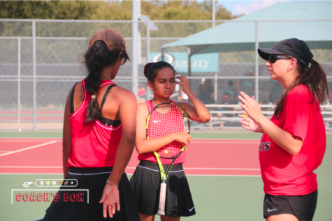 Coppell assistant Natalie Landa coaches junior Rishita Uppuluri and senior Rifhat Sindhi, following up the match against Longview at the CHS Tennis Center on Sept. 28. Landa is using her tennis coaching experiences to work virtually with the Coppell tennis team.