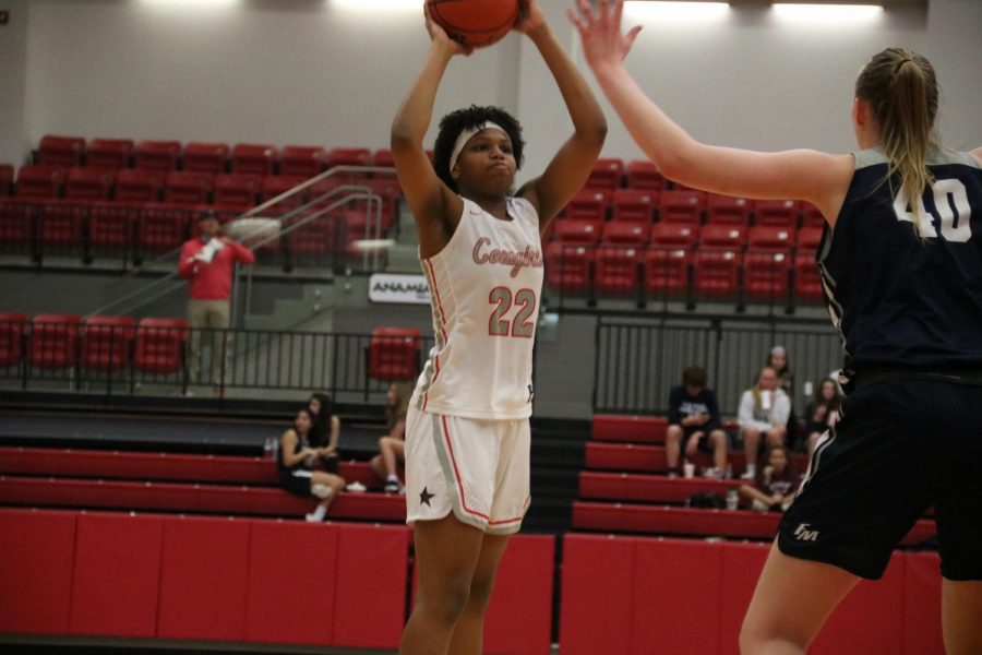 Coppell sophomore forward India Howard attempts to pass against Flower Mound on Feb. 7 in the CHS Arena. Howard uses her experiences in playing basketball to deal with school work.