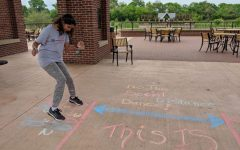 Coppell High School sophomore Dia Atluri follows chalk instructions for the social distance dance on the pavilion floor in Andrew Brown Park East on April 2. Coppell residents are using the extra time provided by the Dallas County issued stay-at-home order to draw colorful chalk messages around the community.