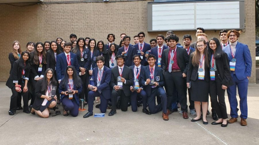 Coppell+High+School+DECA+state+winners+and+finalists+pose+with+their+trophies+and+medals+outside+the+Fort+Worth+Convention+Center+on+Feb.+22.+Sixteen+students+from+CHS+advanced+to+internationals%2C+which+was+canceled+due+to+the+COVID-19+pandemic.+