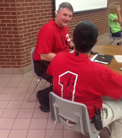 """Administrators Sean Bagley and Ryan Lam represent the Coppell High School slogan """"We Are One"""" during the 2014-2015 school year. Now, after 15 years of working for CHS, Bagley is leaving the district."""